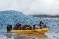 Tourists-get-up-close-and-personal-on-a-Glacier-Explorers-boat-trip